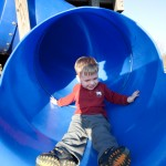 Ethan coming down a blue slide