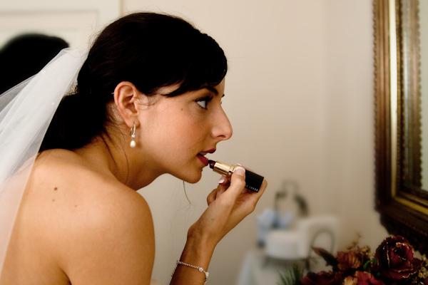 Britt puts on lipstick
