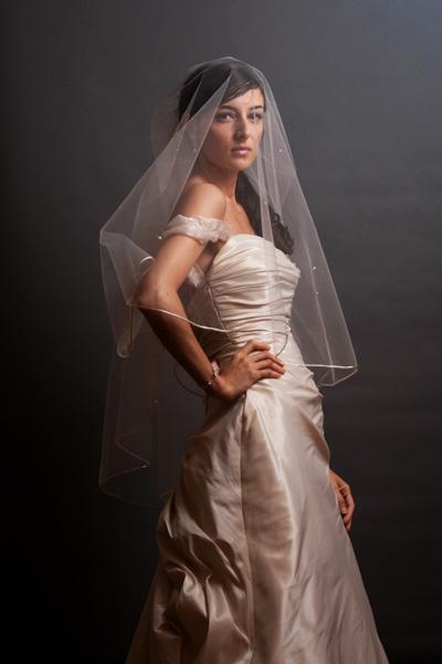Britt standing, wearing her veil