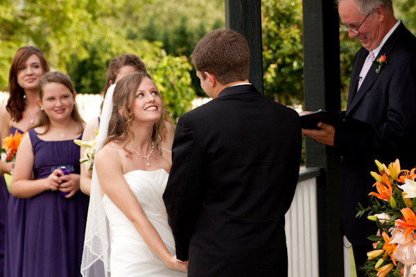 Becky makes a cute face as Danny recites his vows