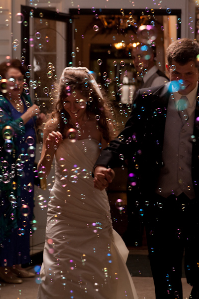 Leaving the reception through a field of bubbles