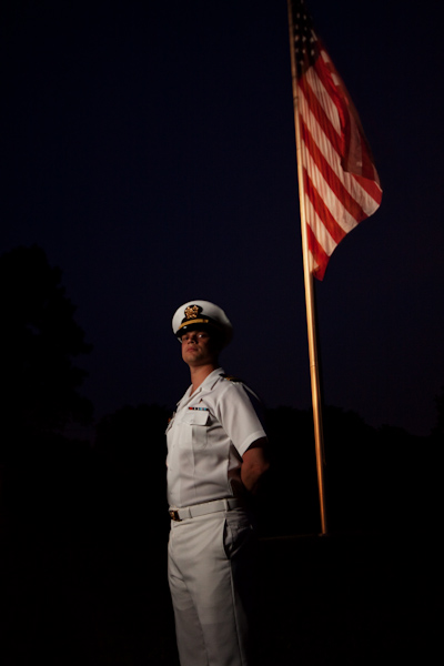 Loren in uniform in front of flag close-up