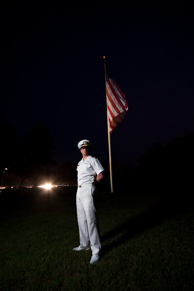 Loren poses in uniform in front of an American flag