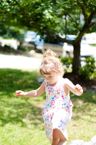 Little girl plays outside