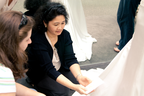 The awesome seamstress instructs the ladies on the bustle