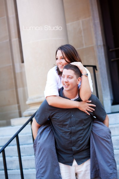 Leah rides on Greg's back in front of the McKissick Museum at USC
