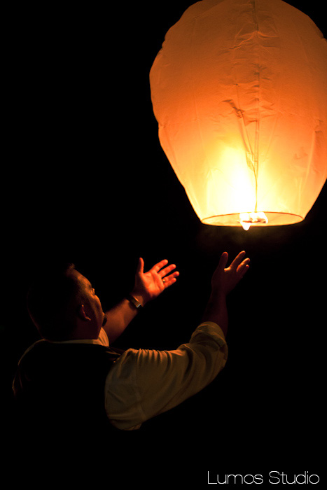 Groom releases a sky lantern at wedding