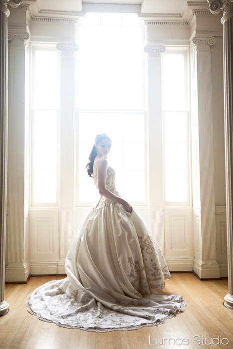 Bride backlit at Society Hall in Charleston, SC
