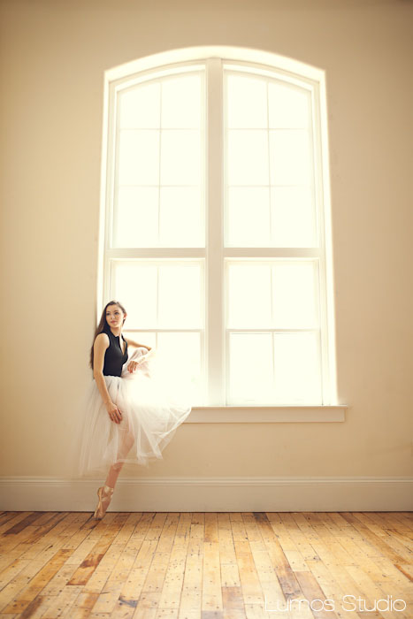 Ballerina sitting in window