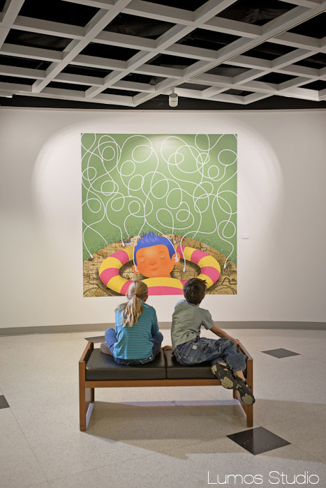 Two kids look at an illustration by Brandon Reese at the Richland Library