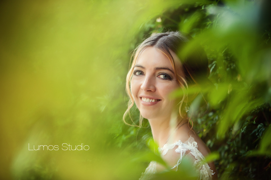 Bride through leaves