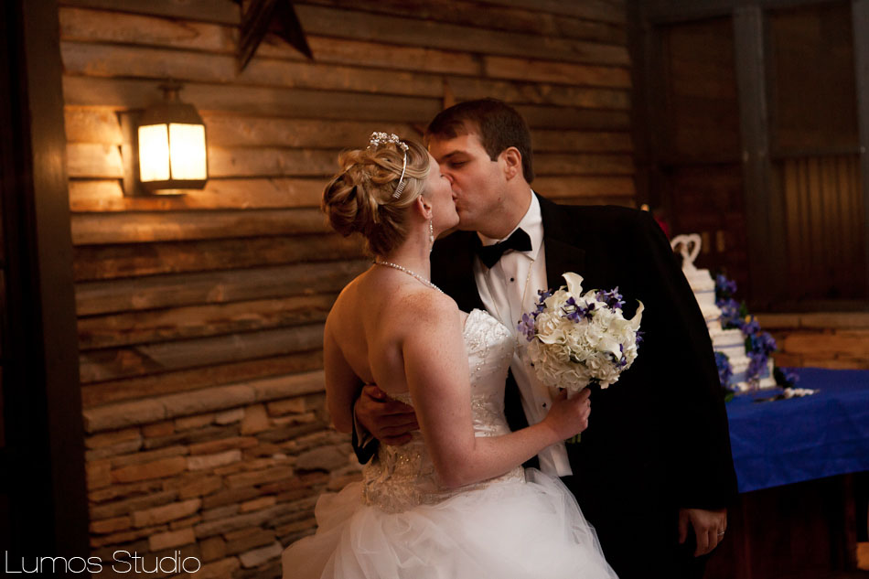 Bride and groom kissing at their wedding at the Saluda River Club