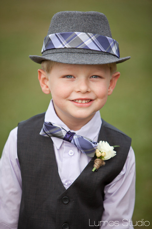Adorable ring bearer in a spiffy hat