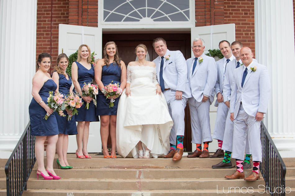The bridal party had colorful shoes and socks