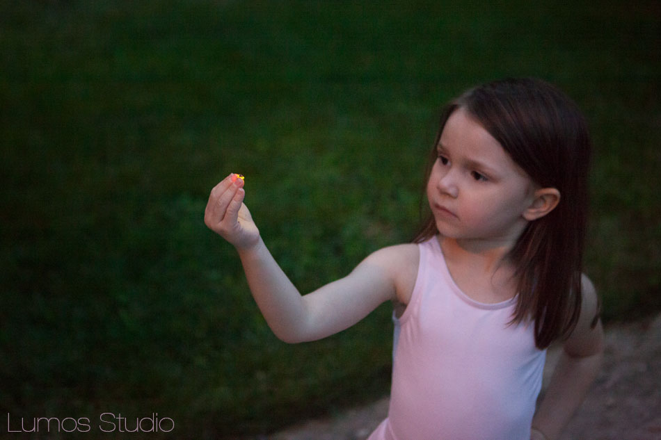 Little girl with lightning bug