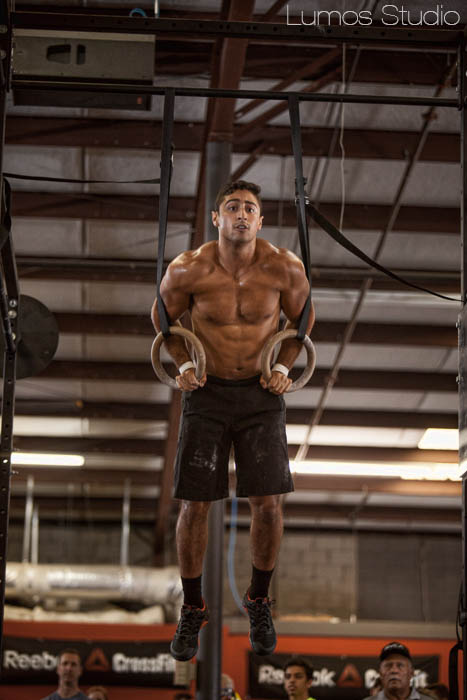 An athlete does muscle-ups at Carolina CrossFit's Famously Hot Showdown