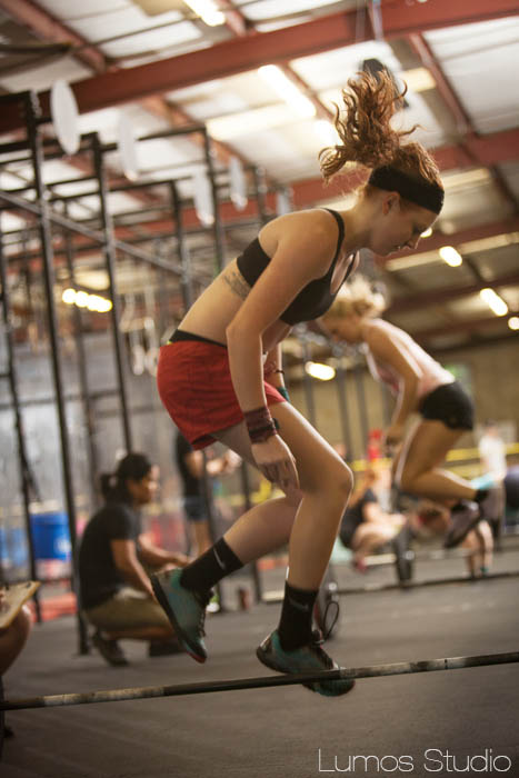 A woman does box jumps during Carolina CrossFit's Famously Hot Showdown