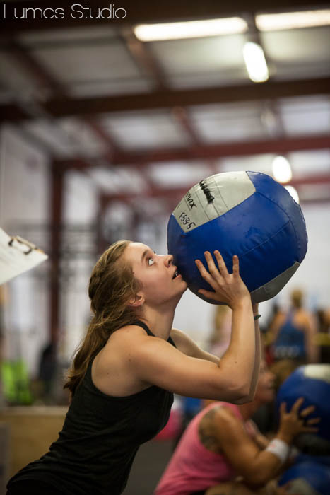 A woman does wall ball during Carolina CrossFit's Famously Hot Showdown