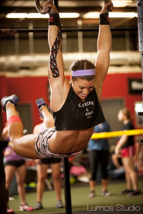 A woman doing muscle-ups