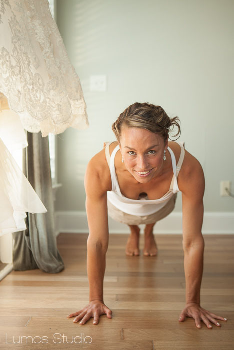 A bride  does yoga before getting into her dress
