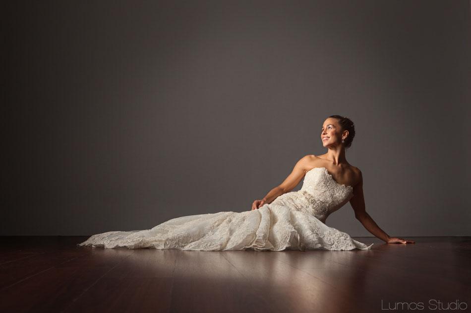 Beautiful bride lying on the floor