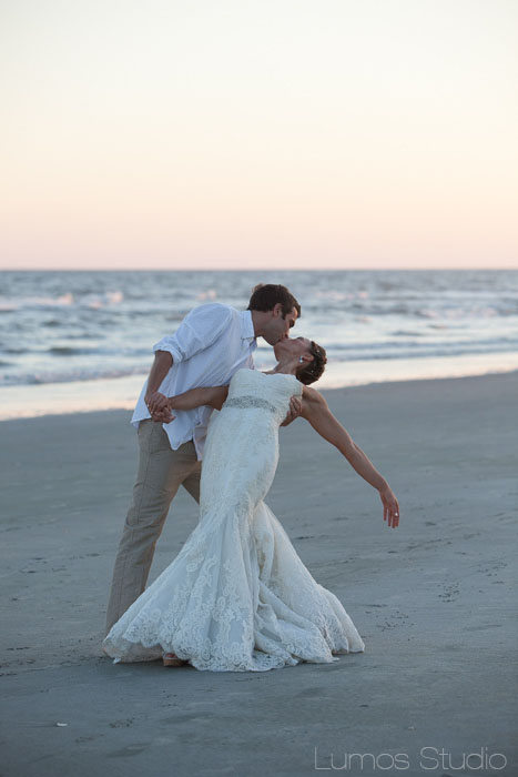 Bride and groom kiss on Folly Beach in South Carolina