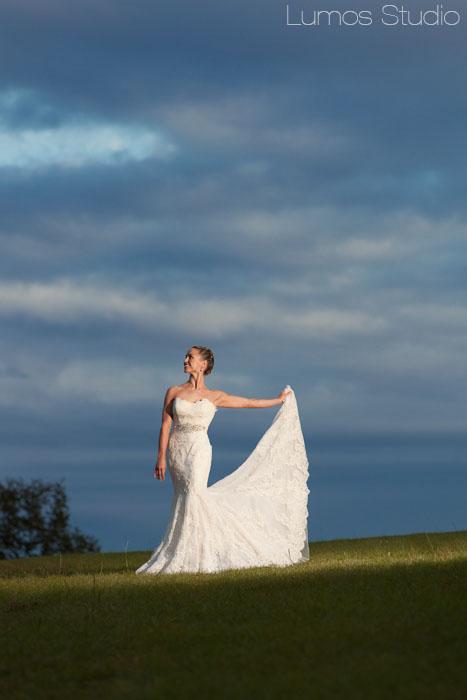 Lovely bride holding her dress