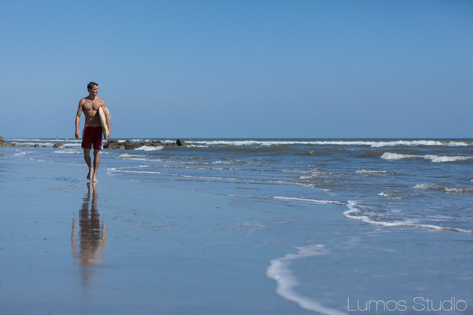 Groom walking in the surf on Folly Beach