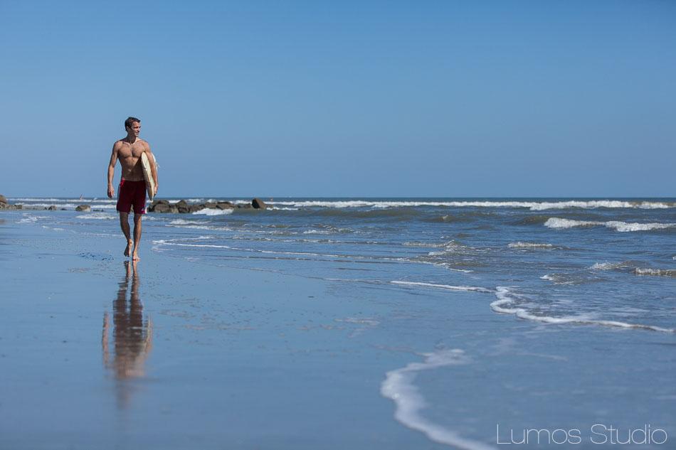 Groom walking in the surf on Folly Beach