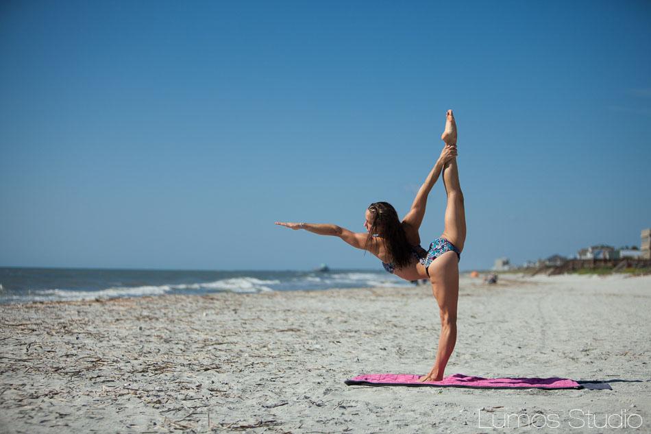 A bride doing yoga on Folly Beach before her wedding