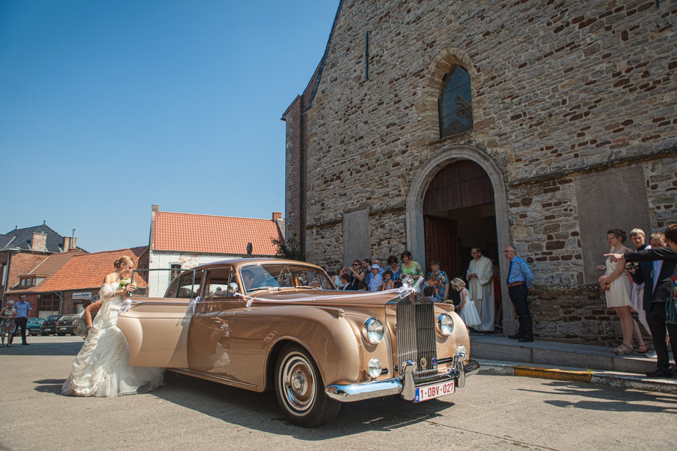A bride arrives at the church in a Rolls Royce