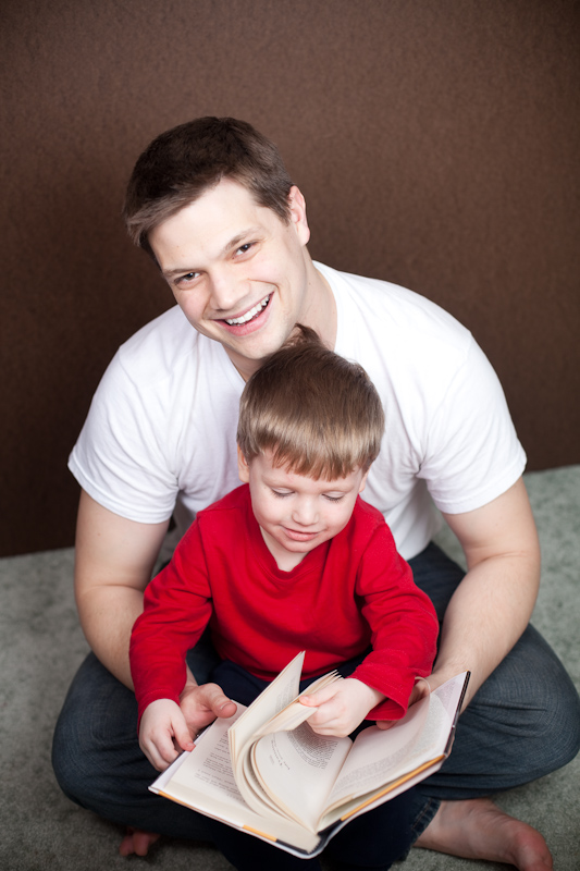 Ethan reads with his daddy